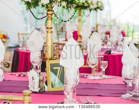 Wedding table with sign number seven. Guests wedding table with sign of number 7