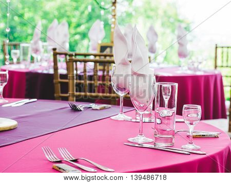 Beautiful dinner wedding table setting, summer outdoor
