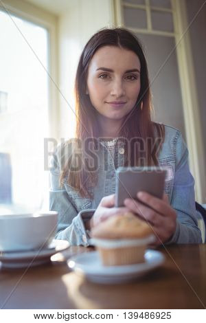 Portrait of beautiful young woman with coffee at cafeteria