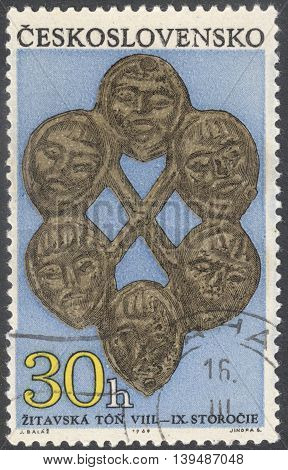 MOSCOW RUSSIA - CIRCA FEBRUARY 2016: a post stamp printed in CZECHOSLOVAKIA shows ornament with 6 masks the series