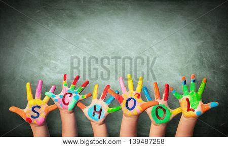 Hands Painted With Blackboard Written School On The Hands