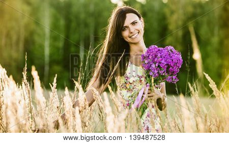 Young happy girl with flowers