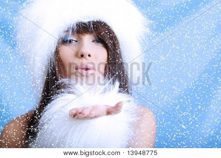 Winter Girl with beautiful make up, silver gloves  and snow flake, blue background