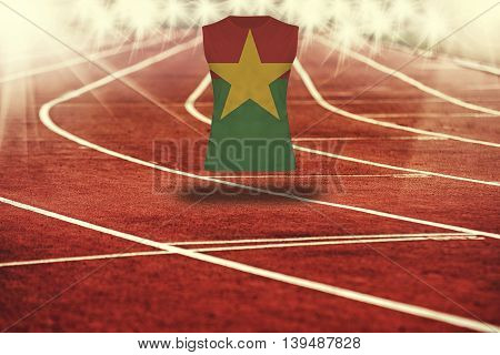 Red Running Track With Lines And Burkina Faso Flag On Shirt
