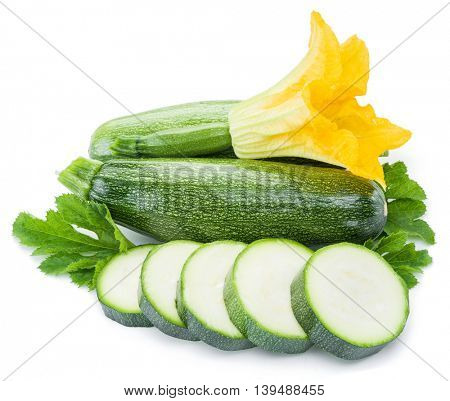Zucchini with slices and flower on a white background.
