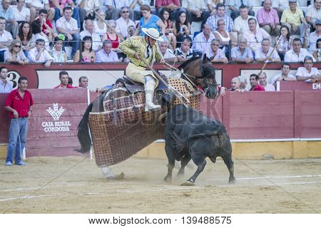 Cabra Spain - September 5 2010: Picador bullfighter lancer whose job it is to weaken bull's neck muscles in the bullring for Ubeda Spain