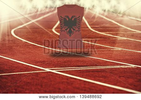 Red Running Track With Lines And Albania Flag On Shirt