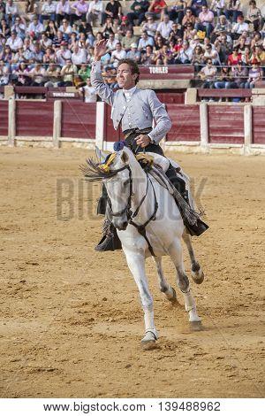 Ubeda SPAIN- October 2 2010: Spanish bullfighter on horseback Leonardo Hernandez bullfighting a gesture of satisfaction and triumph in the bullring of Ubeda Spain