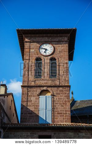 Watch on the brown brick tower in Spain