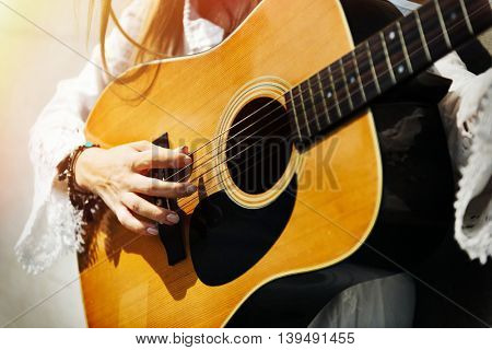 Hippie Woman Playing Music Concept
