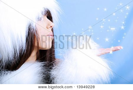 Winter Girl wearing white fur  . snow flake blue  background.