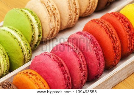Many Traditional French Colorful Macarons In A Box