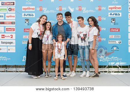 Giffoni Valle Piana SA ITALY - July 21 2016: Actor Sam Claflin on photocall with guys at Giffoni Film Festival 2016 - on July 21 2016 in Giffoni Valle Piana Italy.