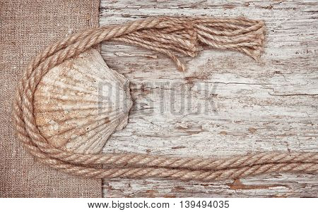 Grunge Background With Seashell, Rope On Sackcloth