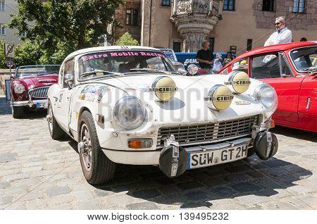 Nurnberg Bavaria / Germany - July 19th 2014: white Triumph GT6 + displayed vintage car street expo