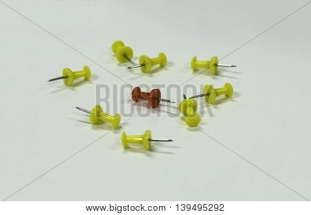 conceptual of leadership red in group of yellow pin isolate on white background - can use to display or montage on product
