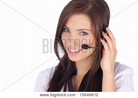 Customer Support girl with headset smiling during a telephone conversation