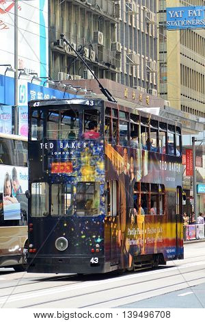 HONG KONG - NOV 9: Hong Kong double deck tram #43 on Des Voeux Road Central near Pottinger Street on Nov 9, 2015 in Hong Kong Island, Hong Kong. Hong Kong Tramways have over 110 years history.
