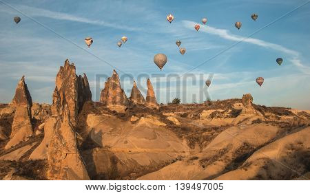 Balloons in the sky over Cappadocia at sunrise in autumn