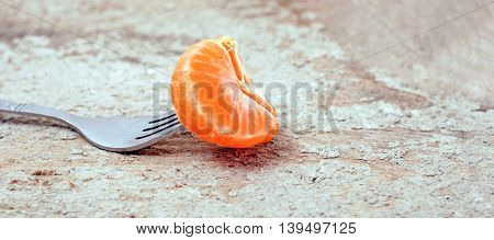 picture of a orange fruit slices on a fork