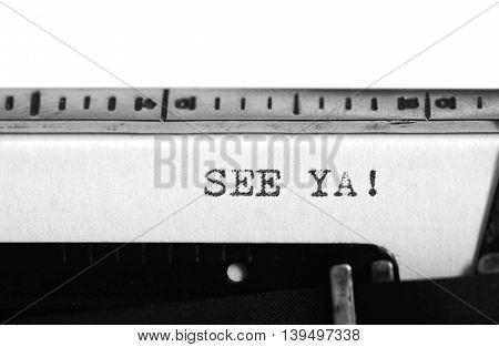 Typewriting on an old typewriter. Typing text: see ya!