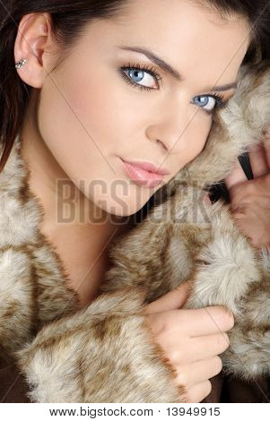 Portrait of a sexy woman wearing winter coat