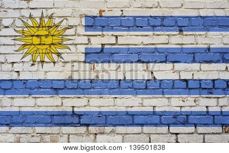 Flag of Uruguay painted on brick wall background texture