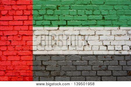 Flag of United Arab Emirates painted on brick wall background tehture