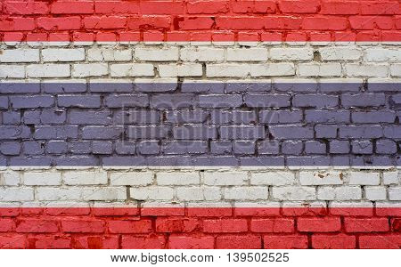 Thailand flag painted on old brick wall texture background