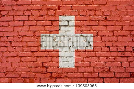 Flag of Switzerland painted on brick wall background texture
