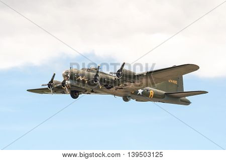 FARNBOROUGH, UK - JULY 17: Vintage Boeing B-17 Flying Fortress bomber in the skies over Farnborough, UK on July 17, 2016