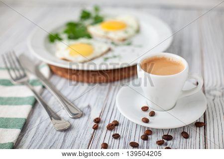fried eggs coffee green fork knife wooden