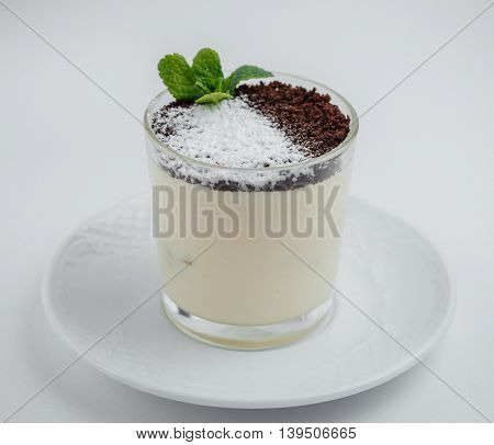 Tiramisu With Chocolate Chips In A Glass On A White Saucer
