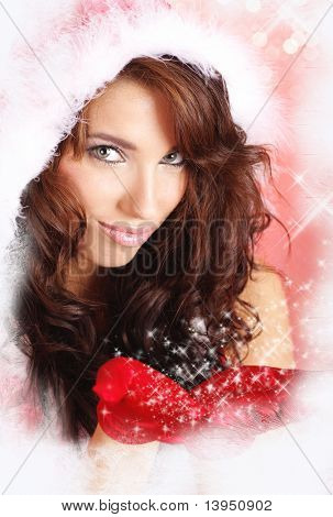 girl in santa cloth on red christmas background