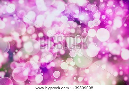 Festive background with natural broken and bright purple lights. Vintage Magic background with colorful broken.