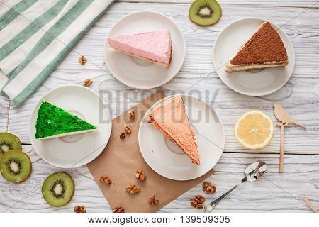 cakes kiwi nuts spoon wooden bird lemon