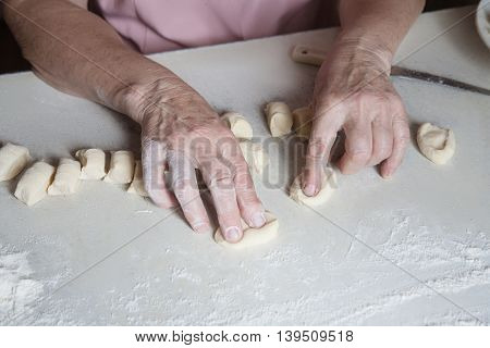 Senior Woman Baking Pies In Her Home Kitchen