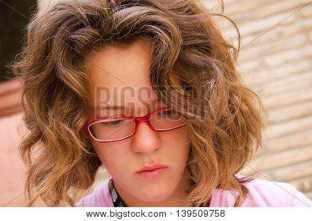 Teenage girl in red glasses looking down. Portrait