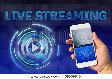 Woman hand holding smartphone against digital blue background LIVE STREAMING concept