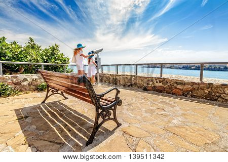 Mother And Daughter On A Seaside Observation Deck