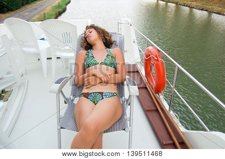 Girl taking a nap on a boat