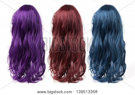 set of long curly wigs on a white background