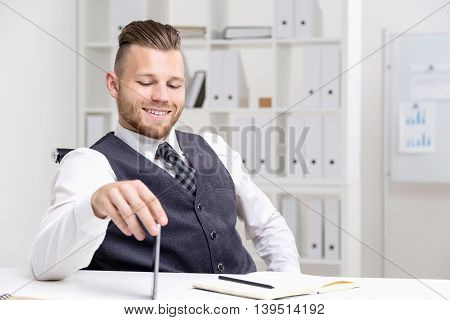 Young Businessman Smiling At Table