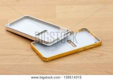 picture of a Case for smartphone. Isolated on wood background