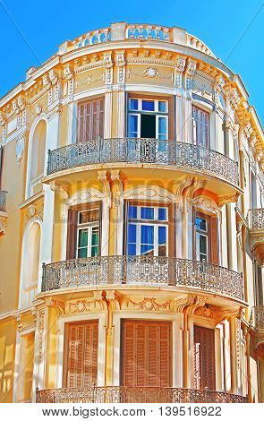 Balcony on the corner of building in Athens, Greece