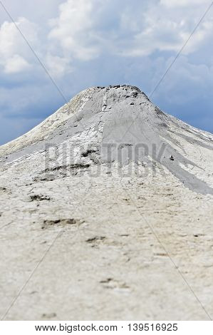 Mud volcano also known as mud dome erupting in summer landscape