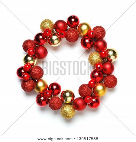 Red and yellow gold christmas wreath decoration on white background
