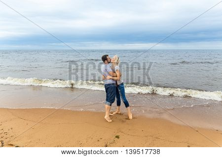 Portrait of young couple kissing on a beach