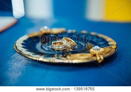 Wedding Gold Rings On A Silver Plate