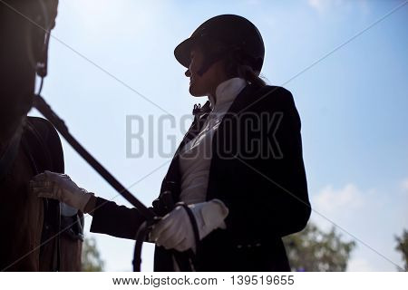 Beautiful Jockey Girl Stand Next To Her Horse.
